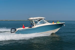Grady-White Freedom 325 32-foot dual console fishing boat running out of inlet