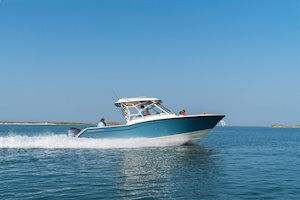 Grady-White Freedom 325 32-foot dual console fishing boat running inshore
