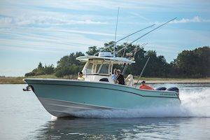 Grady-White Canyon 306 30-foot center console boat running bow forward port side