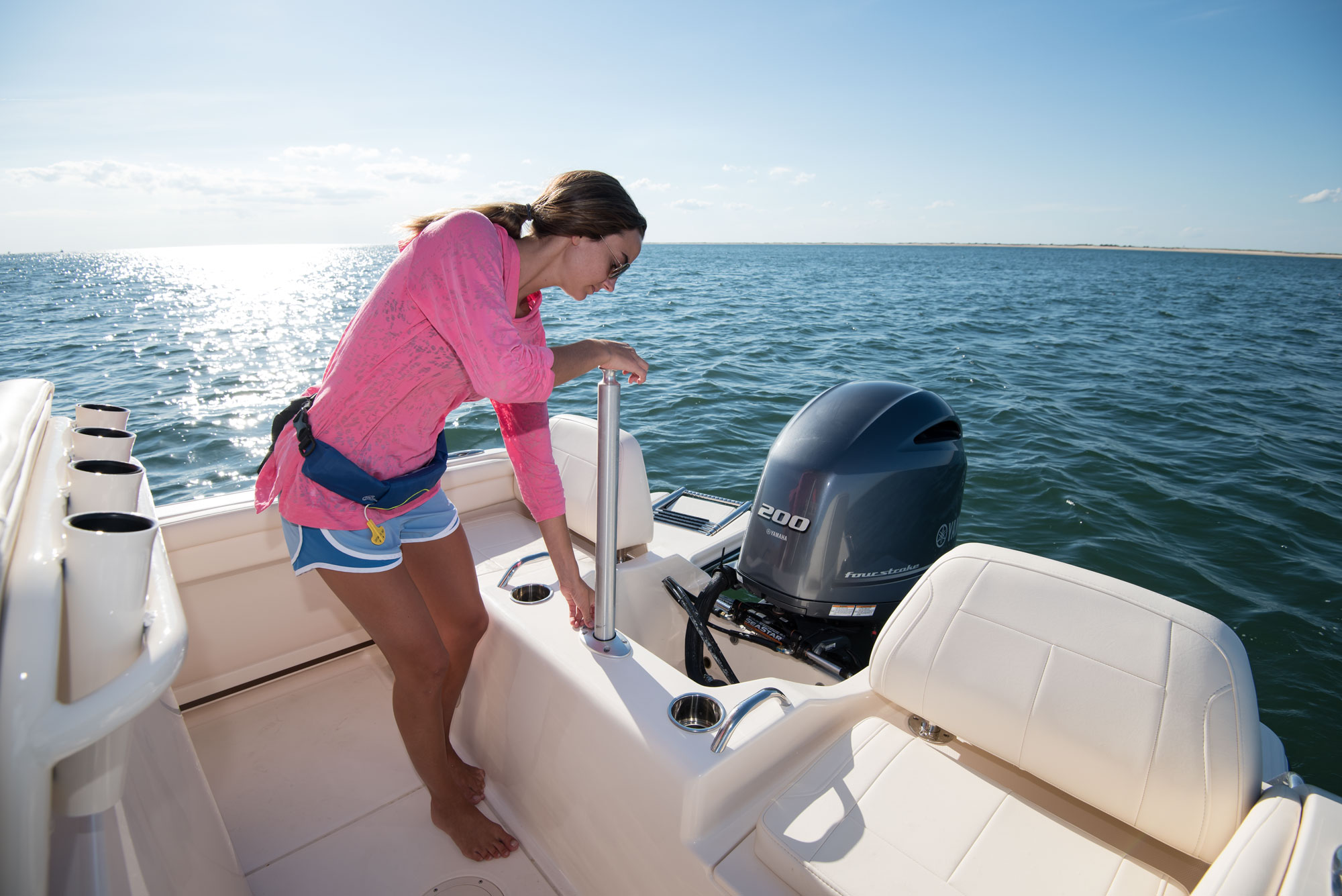 The Fisherman 216 ski pylon is easily accessible to deploy when enjoying watersports.
