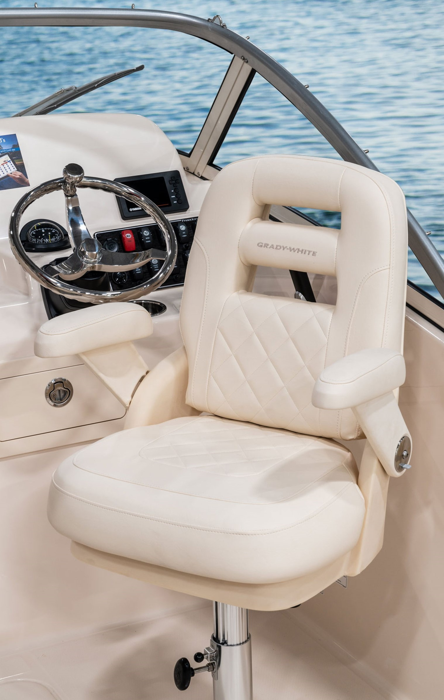 Grady-White Freedom 235 23-foot dual console horizontally and vertically adjustable helm and companion chairs