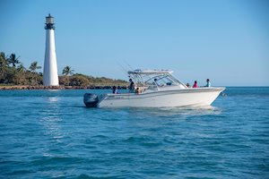 Grady-White Freedom 335 33-foot dual console fishing boat cruising out of inlet