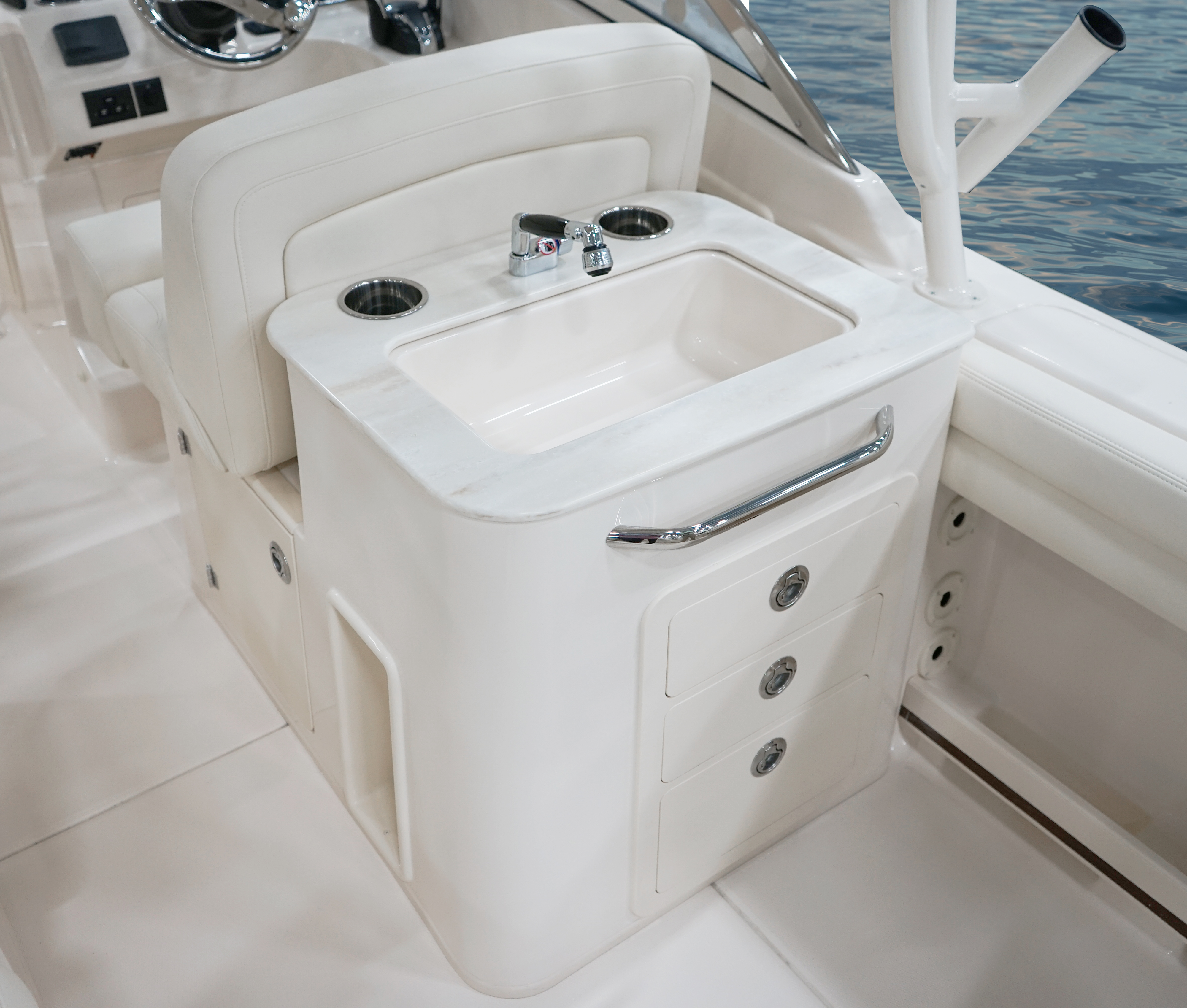 Grady-White Freedom 275 dual console 27 foot deluxe wet bar with sink, grab bar, and storage