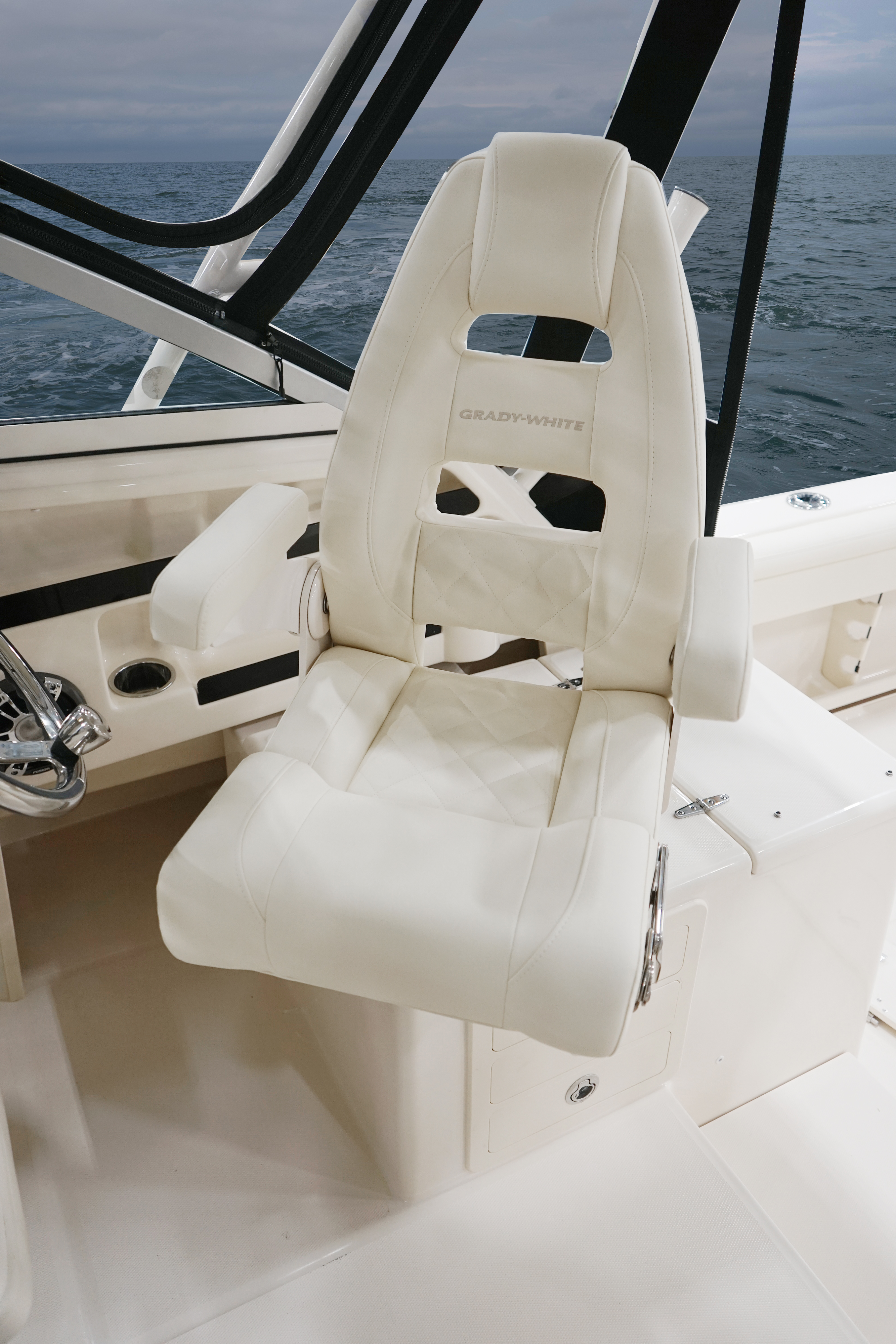 Grady-White Marlin 300, 30-foot walkaround cabin command elite helm chair with flip up bolsters and armrests