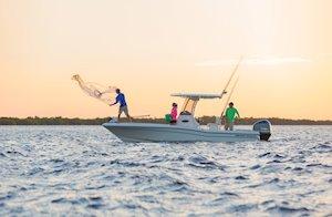 Grady-White 251 CE 25-foot Coastal Explorer fishing boat throwing net