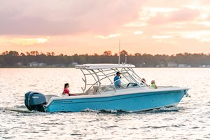Grady-White Freedom 285 28-foot dual console boat sunset starboard side