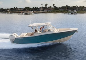Grady-White Freedom 307 30-foot dual console running starboard side Seaport Blue
