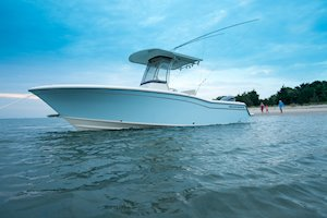 Grady-White Fisherman 236 23-foot center console family on beach